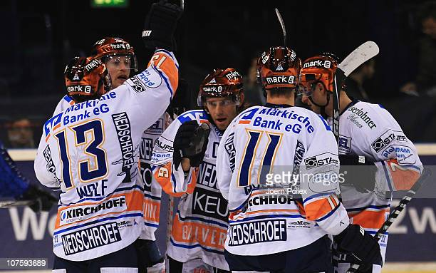 Michael Wolf of Iserlon celebrates with his team mates after scoring his team's first goal during the DEL match between Hamburg Freezers and Iserlohn...