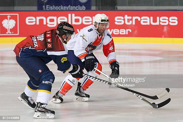 Michael Wolf of Munich and Josh Hennessy of Vaxjo during the Champions Hockey League Round of 32 match between Red Bull Munich and Vaxjo Lakers at...