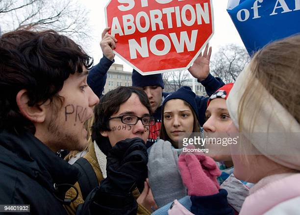 Michael Woodhull left is joined by his friend 16yearold Johannes Schmidt second from left in debate over the issue of abortion with 15yearold Emily...