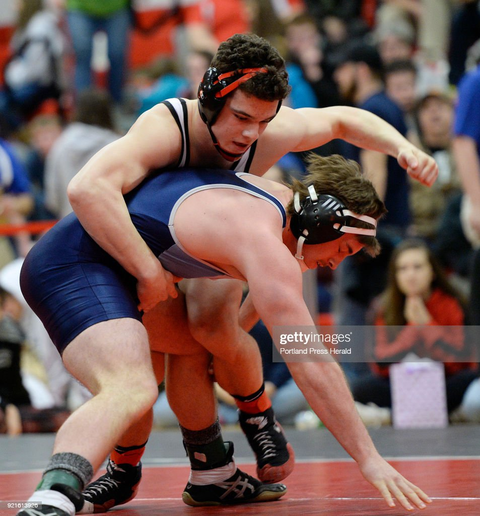Michael Wrigley, top, of Wells battles with Dalton Berry of Dirigo in the 196lb weight class Class B state wrestling championships at Wells High Saturday, February 17, 2018.
