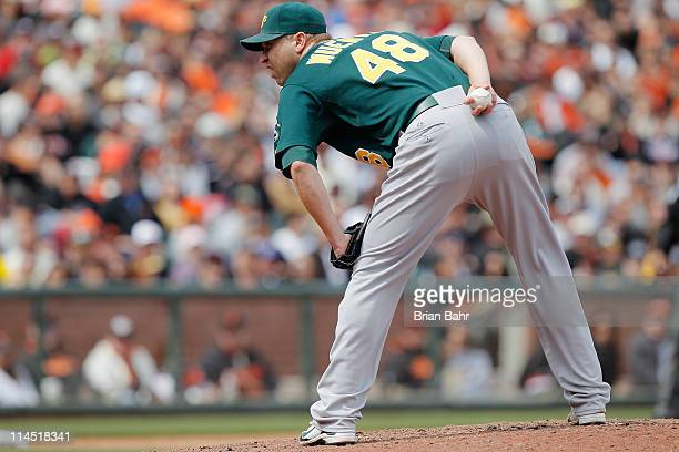 Michael Wuertz of the Oakland A's prepares to throw against the San Francisco Giants at ATT Park on May 22 2011 in San Francisco California The...