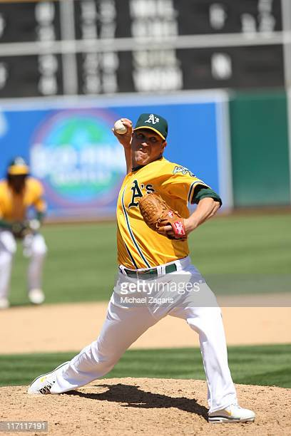 Michael Wuertz of the Oakland Athletics pitches against the Kansas City Royals at the OaklandAlameda County Coliseum on June 16 2011 in Oakland...