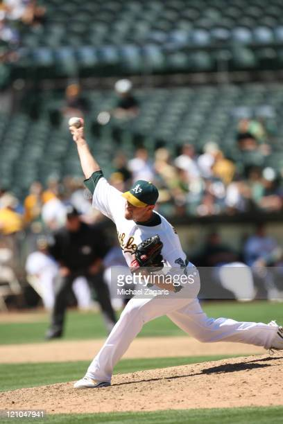 Michael Wuertz of the Oakland Athletics pitches against the Tampa Bay Rays at the OaklandAlameda County Coliseum on July 28 2011 in Oakland...