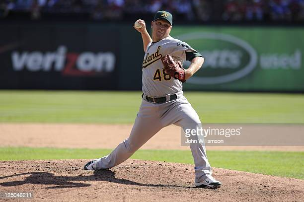 Michael Wuertz of the Oakland Athletics pitches against the Texas Rangers at Rangers Ballpark on September 11 2011 in Arlington Texas The Texas...