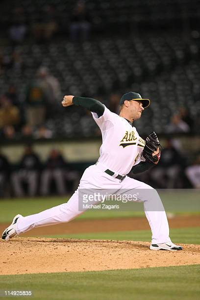 Michael Wuertz of the Oakland Athletics pitches during the game against the Minnesota Twins at the OaklandAlameda County Coliseum on May 18 2011 in...