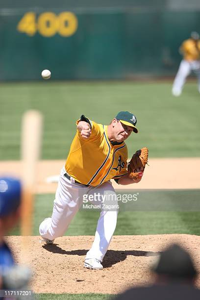 Michael Wuertz of the Oakland Athletics pitches during the game against the Kansas City Royals at the OaklandAlameda County Coliseum on June 16 2011...