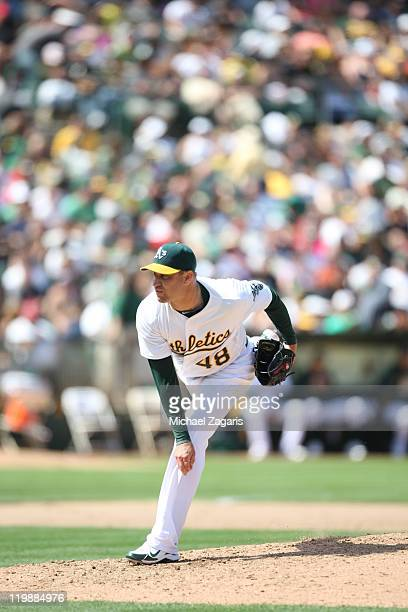 Michael Wuertz of the Oakland Athletics pitches during the game against the LA Angels at the OaklandAlameda County Coliseum on July 16 2011 in...