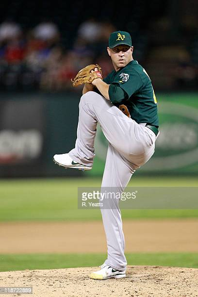 Michael Wuertz of the Oakland Athletics throws a pitch against the Texas Rangers at Rangers Ballpark in Arlington on July 7 2011 in Arlington Texas