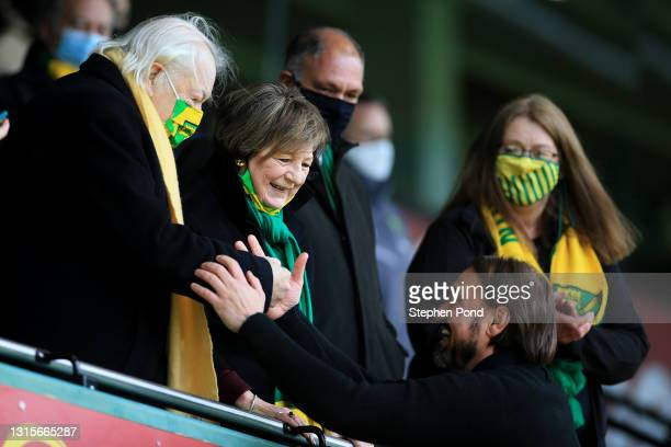 Michael Wynn-Jones and Delia Smith, Owners of Norwich City congratulate Daniel Farke, Manager of Norwich City as their side win the Sky Bet...