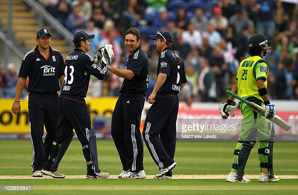 Michael Yardy of England is congratulated by his team mates after taking the wicket of Fawad Alam of Pakistan during the NatWest T20 International...