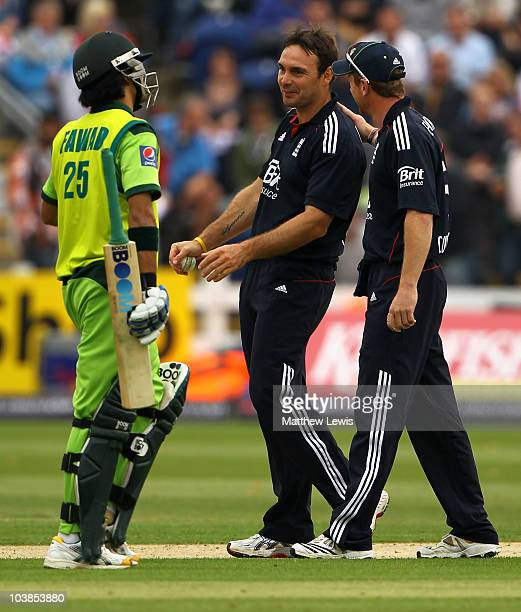 Michael Yardy of England is congratulated by team mate Paul Collingwood after taking the wicket of Fawad Alam of Pakistan during the NatWest T20...