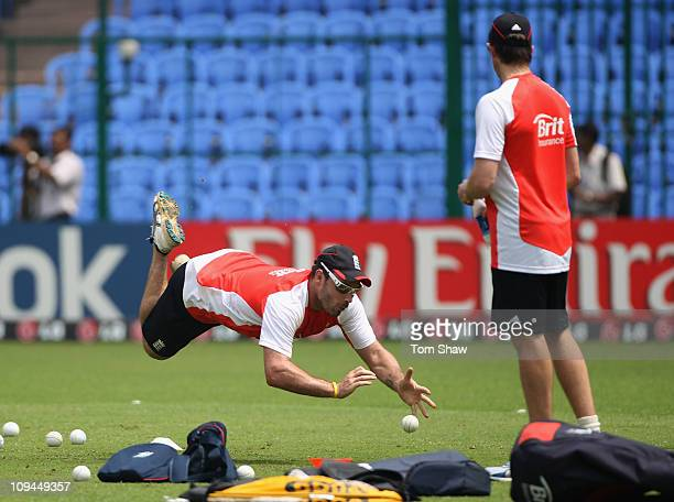Michael Yardy of England takes a diving catch during the England nets session at the M. Chinnaswamy Stadium on February 26, 2011 in Bangalore, India.