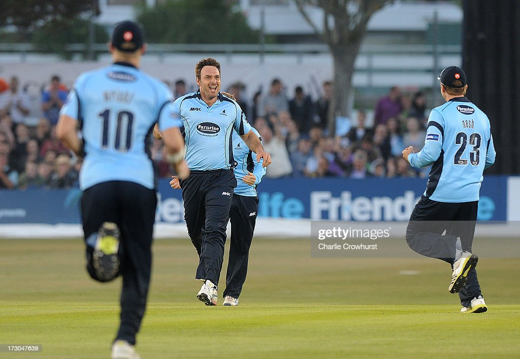 Michael Yardy of Sussex celebrates a wicket with his team mates during the Friends Life T20 match between Sussex Sharks and Hampshire Royals at The Brighton and Hove Jobs County Ground on July 05, 2013 in Hove, England.