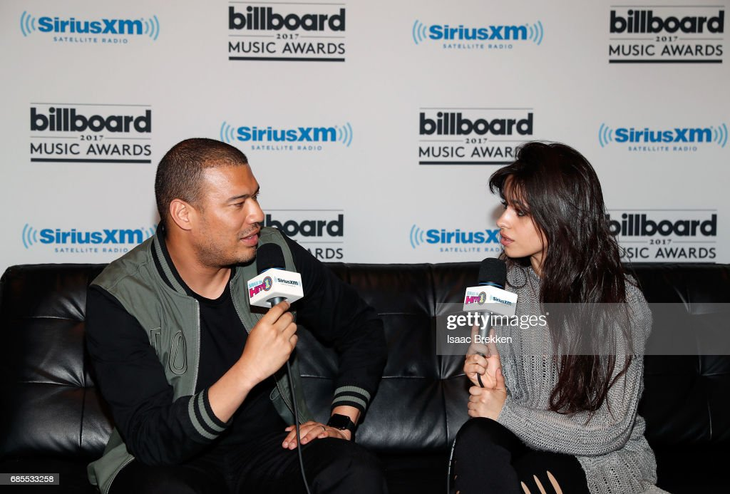 Michael Yo (L) interviews Camila Cabello during SiriusXM's 'Hits 1 in Hollywood' broadcast on SiriusXM's SiriusXM Hits 1 channel leading up to the Billboard Music Awards at T-Mobile Arena on May 19, 2017 in Las Vegas, Nevada.