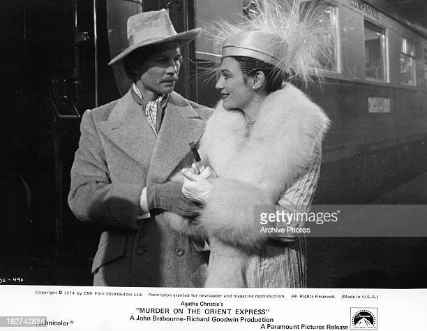 Michael York and Jacqueline Bisset prepare to board the train in a scene from the film 'Murder On The Orient Express' 1974