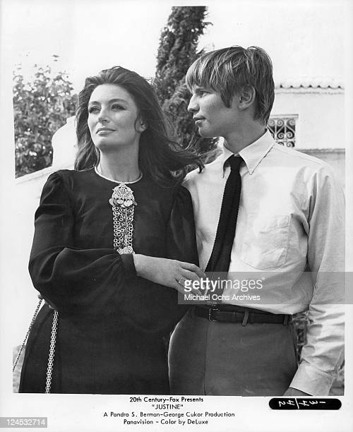 Michael York has his arm around Anouk Aimee in a scene from the film 'Justine' 1969