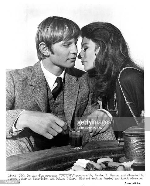 Michael York is seduced by Anouk Aimée in publicity portrait for the film 'Justine' 1969