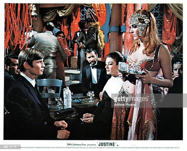 Michael York looks to Anouk Aimée in a scene from the film 'Justine', 1969.