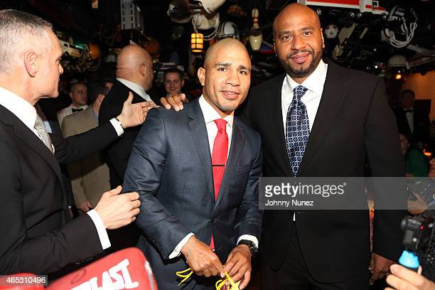 Michael Yormark Miguel Cotto and 'OG' Juan Perez attend the announcement of Miguel Cotto's partnership with Roc Nation Sports at 21 Club on March 5...