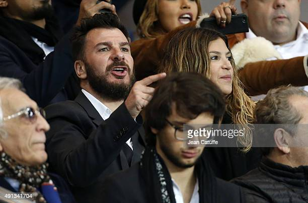 Michael Youn and his wife Isabelle Funaro attend the French Ligue 1 match between Paris SaintGermain FC and Olympique de Marseille at Parc des...