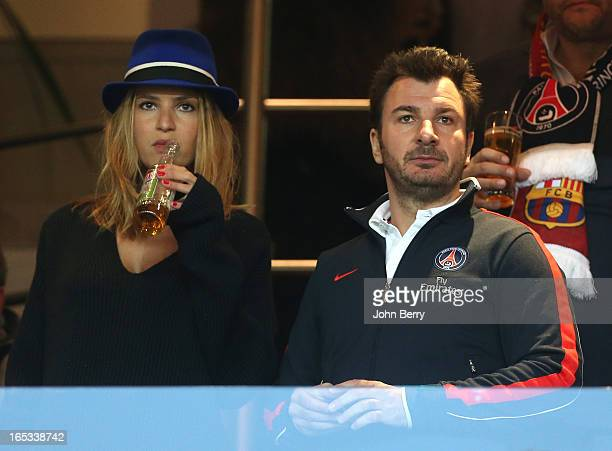 Michael Youn and Isabelle Funaro attend the UEFA Champions League Quarter Final match between Paris SaintGermain FC and FC Barcelona at the Parc des...