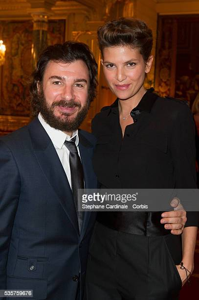 Michael Youn and Isabelle Funaro attends the Ceremony at Elysee Palace in Paris