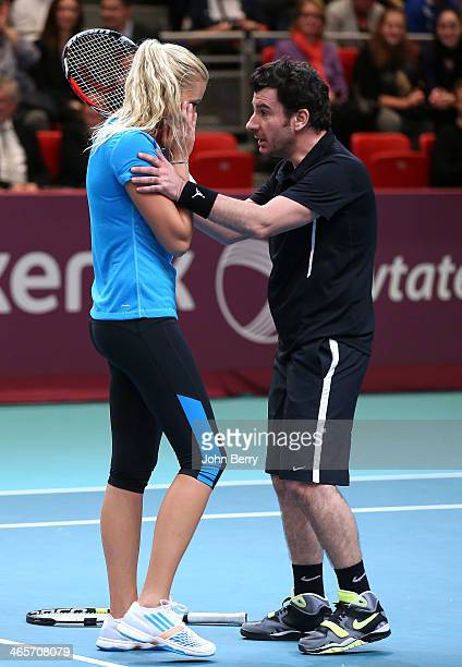 Michael Youn consoles Kristina Mladenovic during the Amelie Mauresmo Tennis Night to benefit the 'Institut Curie' to fight cancer during the 22nd...
