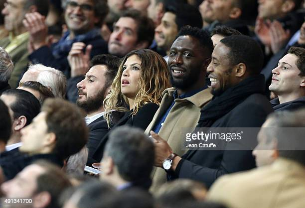 Michael Youn his wife Isabelle Funaro and Thomas N'Gijol attend the French Ligue 1 match between Paris SaintGermain FC and Olympique de Marseille at...