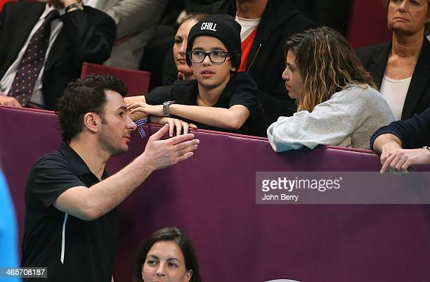 Michael Youn talks with his girlfriend Isabelle Funaro and her son Sean during the Amelie Mauresmo Tennis Night to benefit the 'Institut Curie' to...