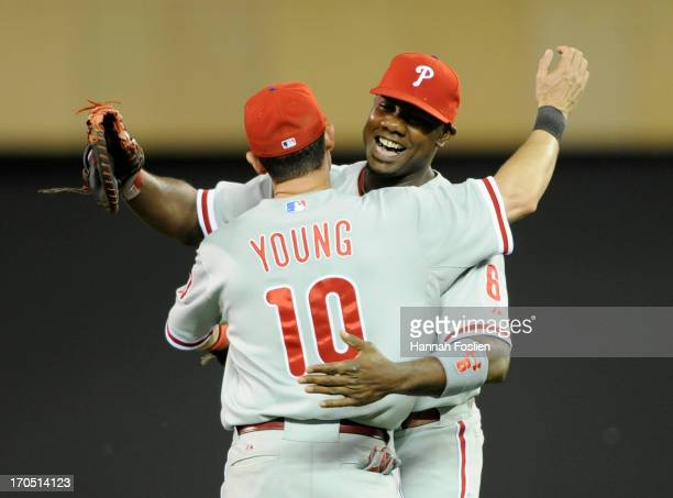 Michael Young and Ryan Howard of the Philadelphia Phillies celebrate a win against the Minnesota Twins on June 13 2013 at Target Field in Minneapolis...