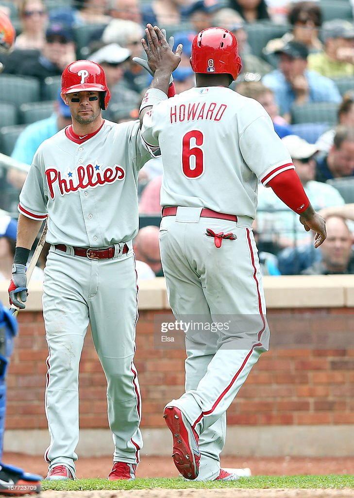 Michael Young #10 congratulates teammate Ryan Howard #6 of the Philadelphia Phillies after he scored in the seventh inning on April 28, 2013 at Citi Field in the Flushing neighborhood of the Queens borough of New York City.