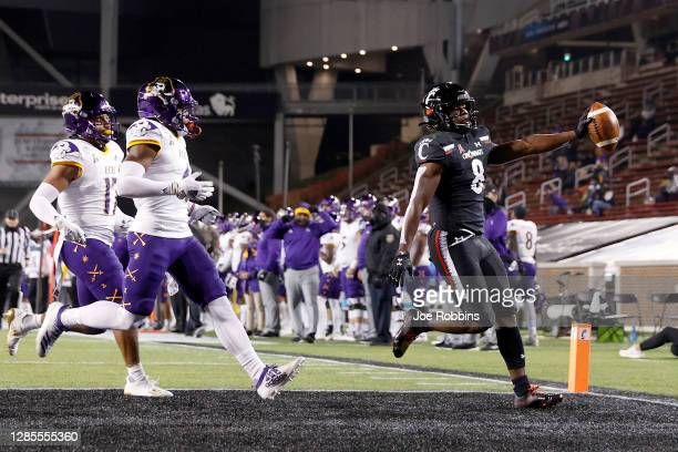 Michael Young Jr. #8 of the Cincinnati Bearcats runs into the end zone with a 33-yard touchdown reception against the East Carolina Pirates in the...