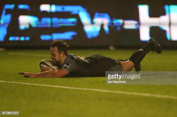 Michael Young of Newcastle Falcons scores the opening try during the AngloWelsh Cup match between Newcastle Falcons and Cardiff Blues at Kingston...