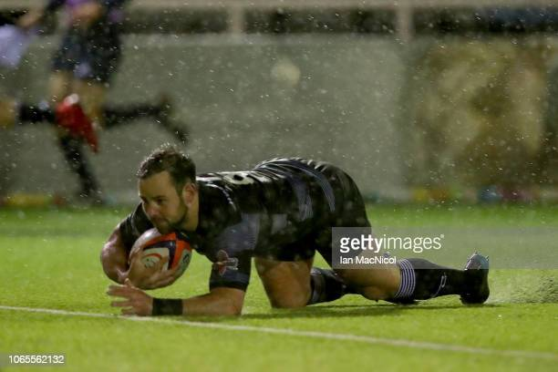Michael Young of Newcastle scores a try during the Premiership Rugby Cup match between Newcastle Falcons and Bath Rugby at Kingston Park on November...