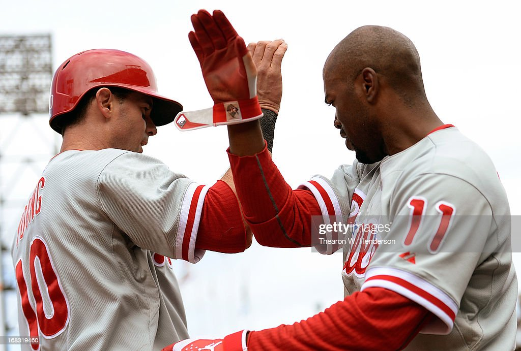 Michael Young #10 of the Philadelphia Phillies is congratulated by Jimmy Rollins #11 after Young scored the tying run against the San Francisco Giants in the ninth inning at AT&T Park on May 8, 2013 in San Francisco, California. Young made the score 3-3 on a Delmon Young sacrifice fly.