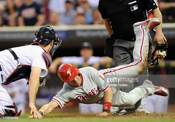 Michael Young of the Philadelphia Phillies is out as Joe Mauer of the Minnesota Twins defends home plate during the sixth inning of the game on June...