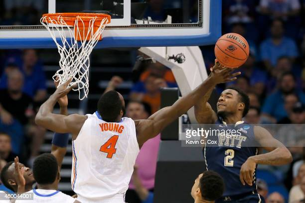 Michael Young of the Pittsburgh Panthers blocks the shot of Patric Young of the Florida Gators in the first half during the third round of the 2014...