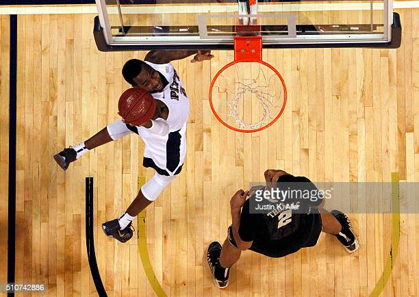 Michael Young of the Pittsburgh Panthers drives to the basket during the game against Devin Thomas of the Wake Forest Demon Deacons at Petersen...