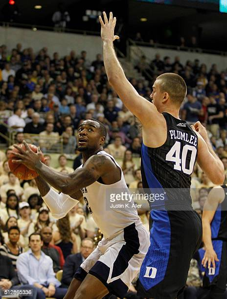 Michael Young of the Pittsburgh Panthers handles the ball during the game against Marshall Plumlee of the Duke Blue Devils at Petersen Events Center...