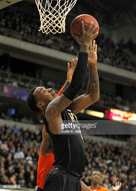 Michael Young of the Pittsburgh Panthers lays one in against the Syracuse Orange during the game at Petersen Events Center on February 7 2015 in...