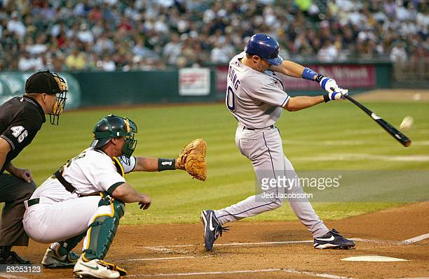 Michael Young of the Texas Rangers bats against the Oakland Athletics during the game at the Network Associates Coliseum on September 15 2004 in...