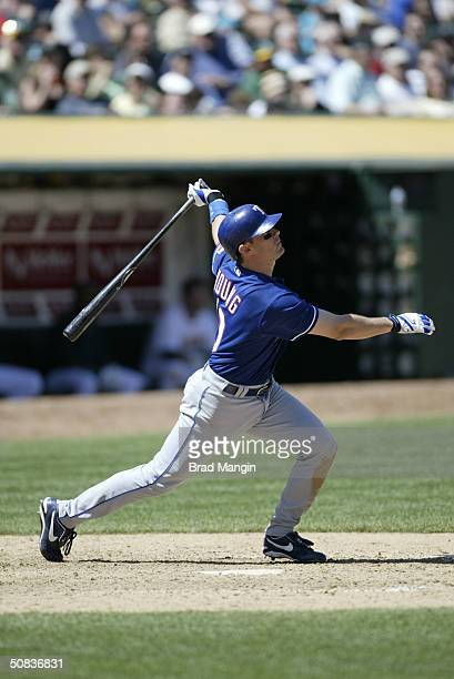 Michael Young of the Texas Rangers bats during the MLB game against the Oakland Athletics at Network Associates Coliseum on April 7 2004 in Oakland...