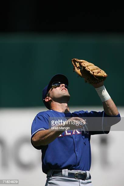 Michael Young of the Texas Rangers catches a pop fly during the game against the Oakland Athletics at the Network Associates Coliseum in Oakland,...