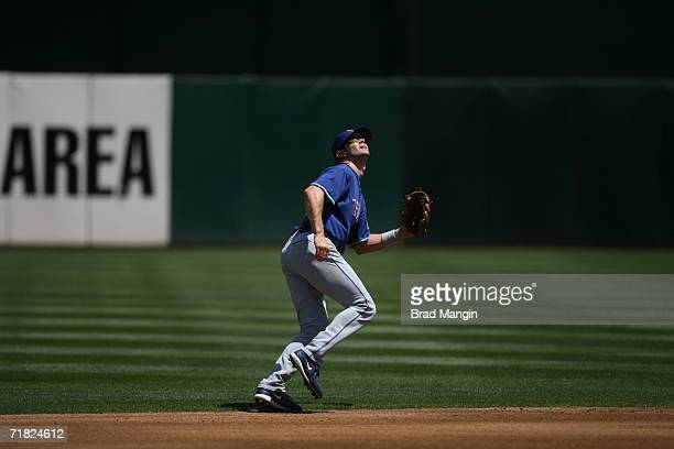Michael Young of the Texas Rangers judges a fly ball during the game against the Oakland Athletics at the Network Associates Coliseum in Oakland,...