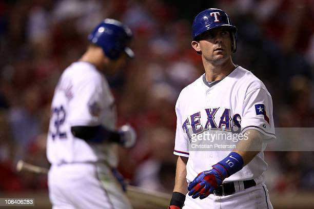 Michael Young of the Texas Rangers reacts as he walks back to the dugout after he struck out in the seventh inning against the San Francisco Giants...