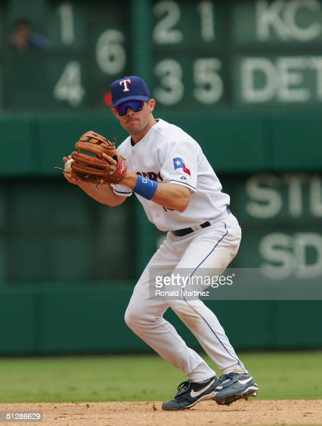 Michael Young of the Texas Rangers throws against the Chicago White Sox on September 6 2004 at Ameriquest Field in Arlington in Arlington Texas