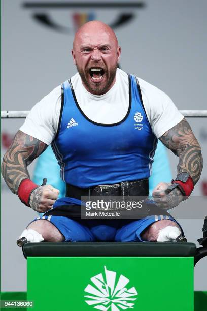 Michael Yule of Scotland celebrates after a successful lift during the Para Powerlifting on day six of the Gold Coast 2018 Commonwealth Games at...