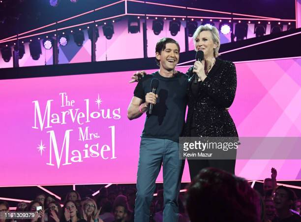 Michael Zegen and Jane Lynch speak onstage as Taylor Swift Dua Lipa SZA and Becky G perform at The Prime Day concert presented by Amazon Music at on...