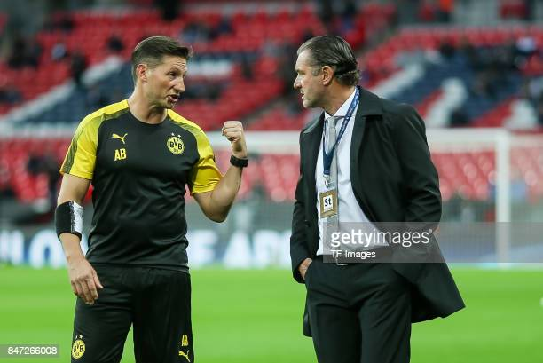 Michael Zorc of Dortmund speak with Andreas Beck of Dortmund during the UEFA Champions League group H match between Tottenham Hotspur and Borussia...