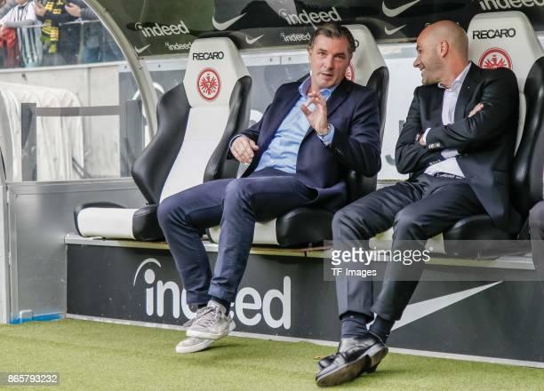 Michael Zorc of Dortmund speaks with Head coach Peter Bosz of Dortmund prior the Bundesliga match between Eintracht Frankfurt and Borussia Dortmund...